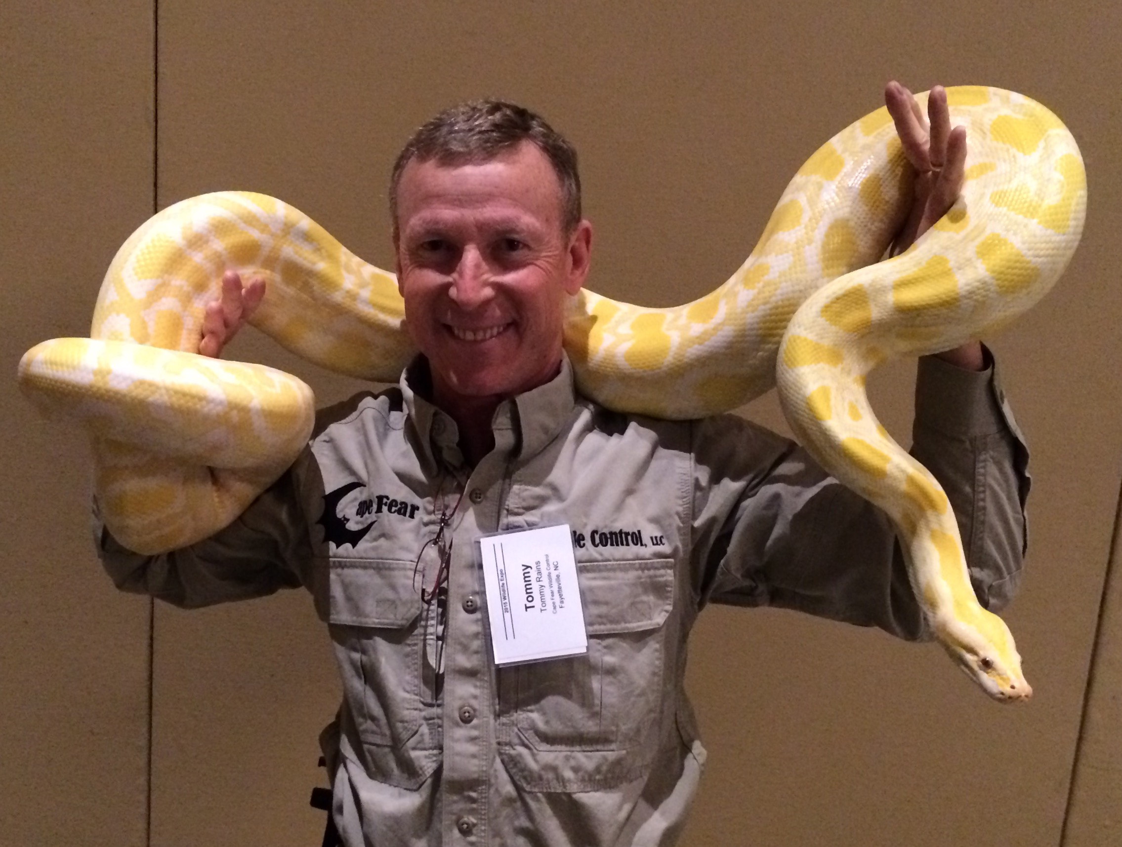 Tommy Holding Ten Foot Long Albino Python